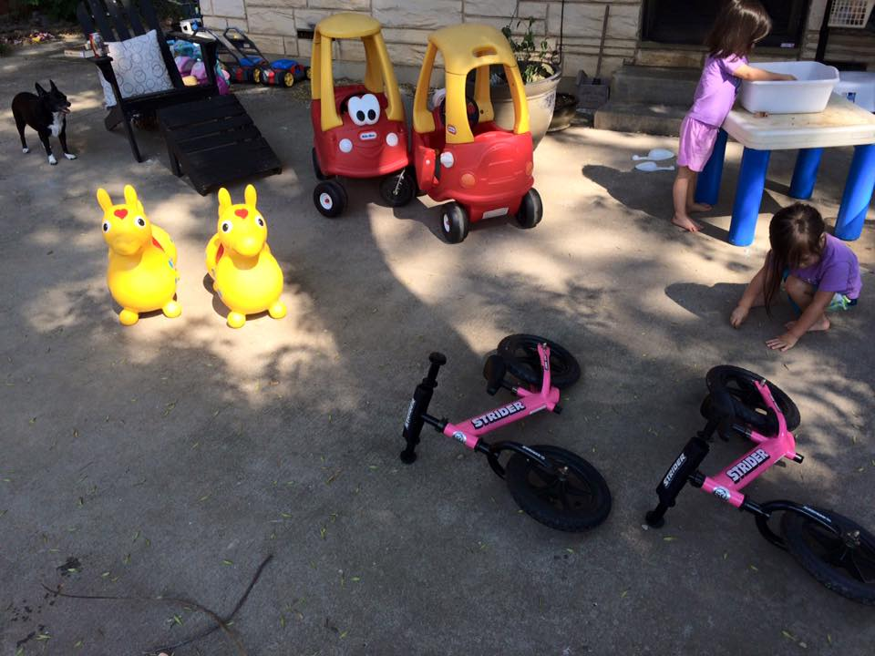 Cars for Costco trips, Rody the bounce horse who is more petted and fed than ridden, and balance bikes